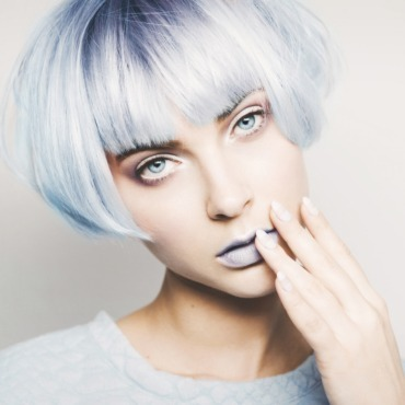 Studio portrait of beautiful girl with blue hair